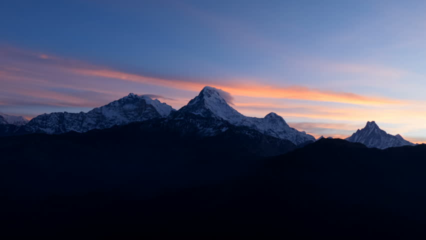Aerial view of Himalayas Nepal mountain peak. Time-lapse 4k video nature, background. Twilight sunrise and clear sky.