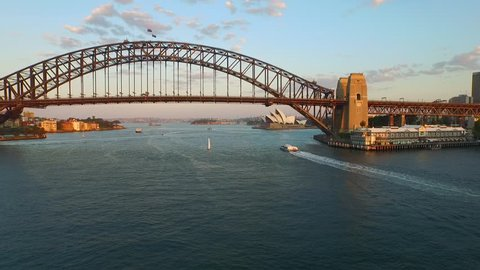 Aerial views of Sydney Harbour Bridge, from helicopter featuring Sydney CBD, Sydney Ferries (ferry), in Port Jackson on the Parramatta River.