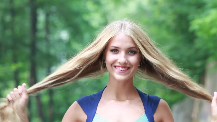 Beautiful girl with long white hair thick hair develops