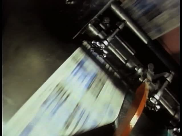 Newspapers printing during press run at printing plant