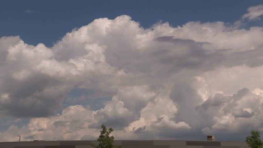Waterloo, Ontario, Canada August 2016 Thunderstorm cumulonimbus cloud exploding on hot summer day