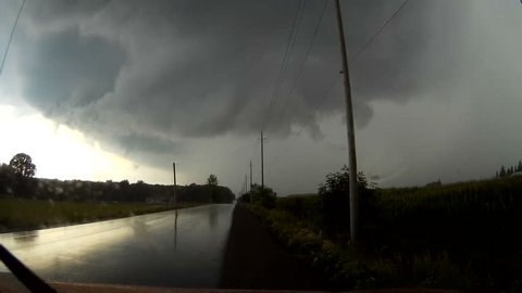 Waterloo, Ontario, Canada August 2016 POV dashcam driving into severe thunderstorm with wall cloud forming