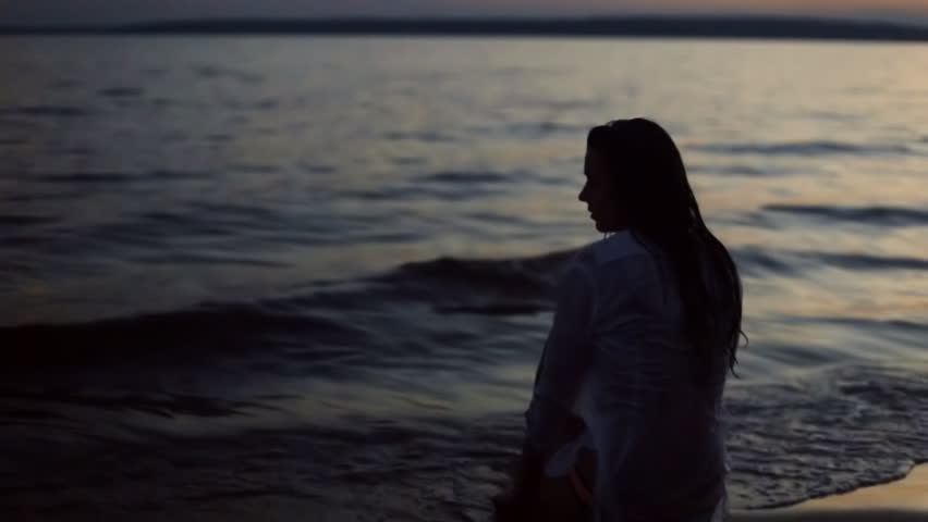 girl sitting on the beach at night #18534842