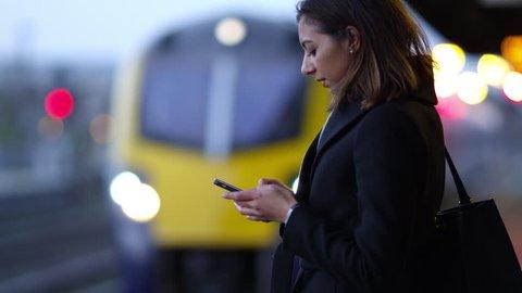 Businesswoman On Platform Waiting For Train Shot On R3D
