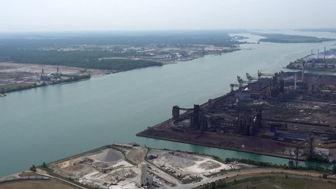 Detroit, ZUG ISLAND AERIAL. 4k, 2016 includes river, and island with steel mill, coal piles, and general dystopian atmosphere.