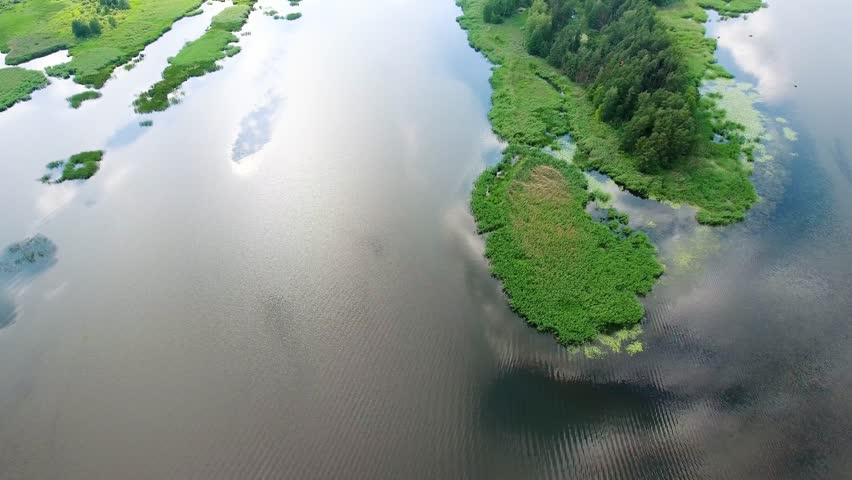 Beautiful river with green banks | Shutterstock HD Video #18592322