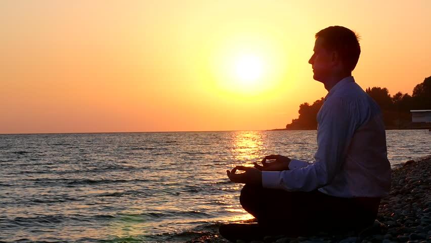 Businessman Sitting On The Beach