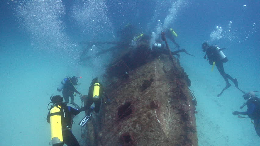 Chaotic hoard of scuba divers swimming on wreckage in Queensland, Australia Circa 2016, HD, UP24398 | Shutterstock HD Video #18618251