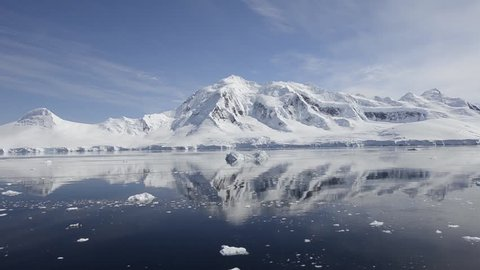 Motion of glaciers and mountains reflecting in Gerlache Strait in Antarctic (Gerlache Strait, Antarctica 2010s)