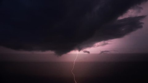 Lightning flashes in a sky during a strong thunderstorm