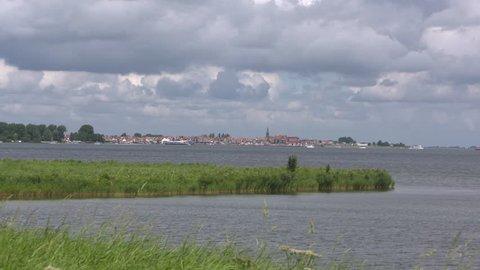 Skyline Volendam, a characteristic Dutch fishing village, behind the Gouwzee, part of the Markermeer. VOLENDAM, THE NETHERLANDS.