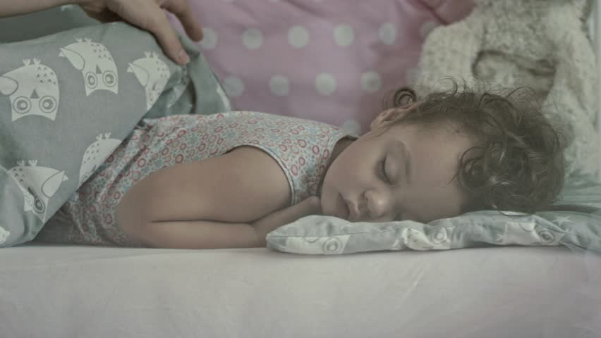 Beautiful mother with her 16 months old baby sleeping, slow motion clip