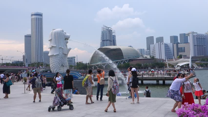 SINGAPORE - 07 AUGUST, 2016: The Merlion fountain in Singapore. Merlion is a imaginary creature with the head of a lion,seen as a symbol of Singapore
