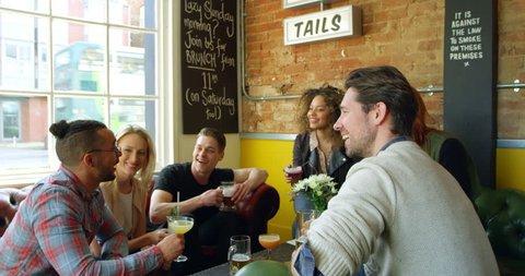 Friends Enjoying Drink In Bar Sitting On Sofa Shot On R3D