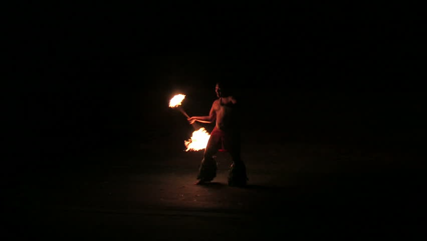 LAIE, OAHU, HAWAII CIRCA FEB 2008: BYU Hawaii student twirls fire baton at night and demonstrate Polynesian Island customs to earn tuition money in Hawaii circa February  2008 in Lake Oahu, Hawaii.