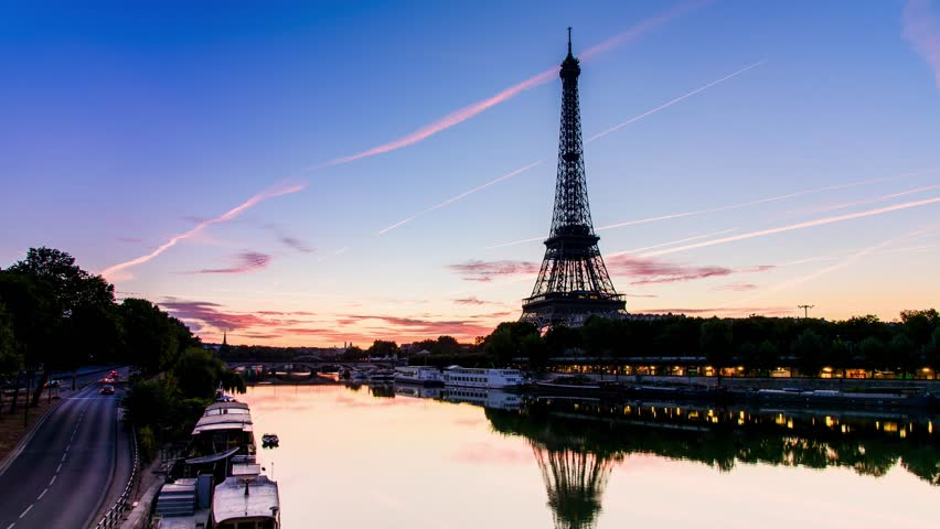 PARIS - AUG 14: Sunrise of Eiffel Tower from Bir Hakeim Bridge and seine river and the blue sky with the cloud from airplane on August 14, 2016. The Eiffel tower is the most visited monument of France