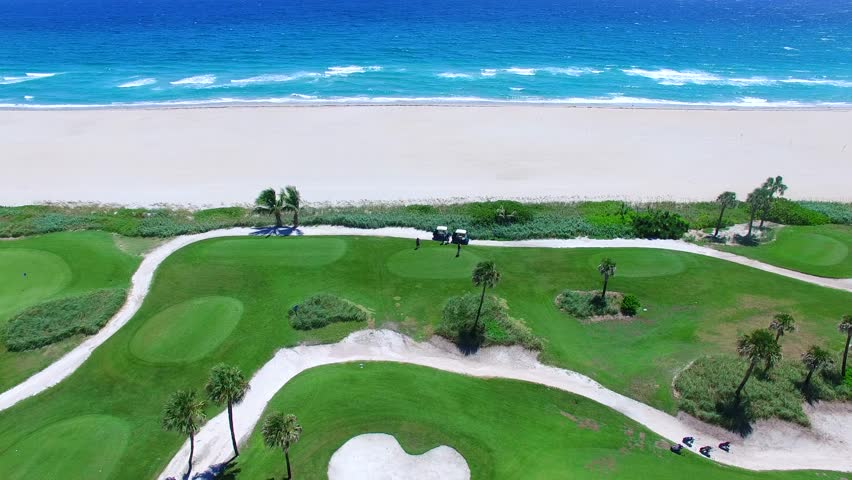 4k Aerial - Beautiful view of Golf Course next to ocean going back on the field