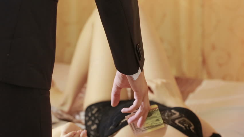 The man pays a prostitute with american money dollar . Prostitute concept