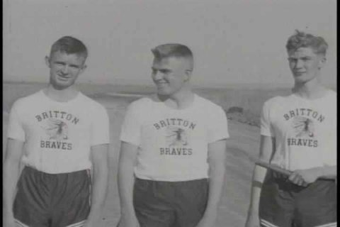 A member of the Britton Track Team throws a discus, boys wrestle, and the track team practices sprinting and running relays in Britton, South Dakota in the 1930s. (1930s)