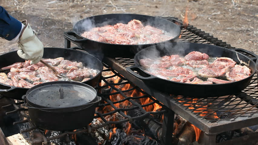 Bbq Lamb And Mutton Steaks Chops Cooking In Cast Iron Pans Over An Open Outdoor Fire Cowboy Sheep Camp Party Fresh Meat With Smoke Oil
