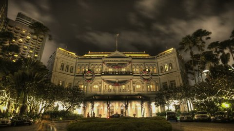Timelapse of the Raffles Hotel at night on December 25, 2011 in Singapore. Opened in 1899, it was named after Singapore's founder Sir Stamford Raffles.