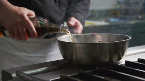 Cooking slowmotion in a restaurant