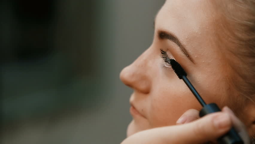 Make-up artist makes make-up eyelashes in a young woman.Makeup. Cosmetic. Base for Perfect Make-up.Applying Make-up.