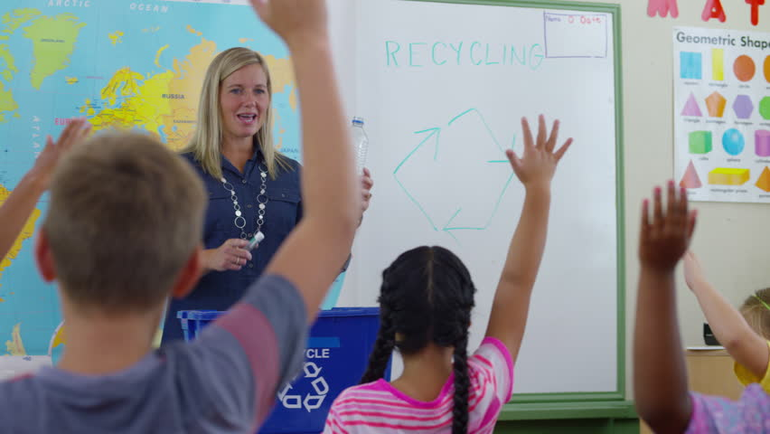 Young teacher using interactive whiteboard to display the world teacher giving recycle lesson in school classroom 4k stock footage clip gumiabroncs Gallery
