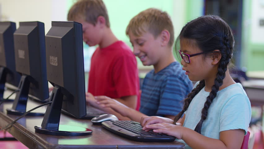 Row of students work on computers at school | Shutterstock HD Video #19004659