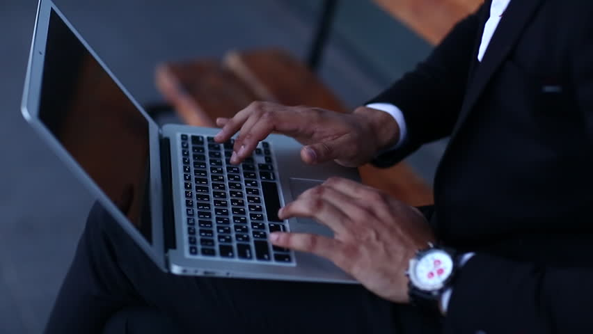 Young Black Man Typing Something Important In A Laptop And -5714
