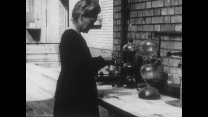 UNITED STATES 1900s: Intertitle / Medium shot of Theodore Roosevelt / Intertitle / Marie Curie in lab / Close up of Curie / Intertitle / Close up, Thomas Edison in car.