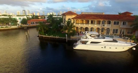 Aerial shot of the yacht near luxury villa, Miami Beach, Atlantic Ocean