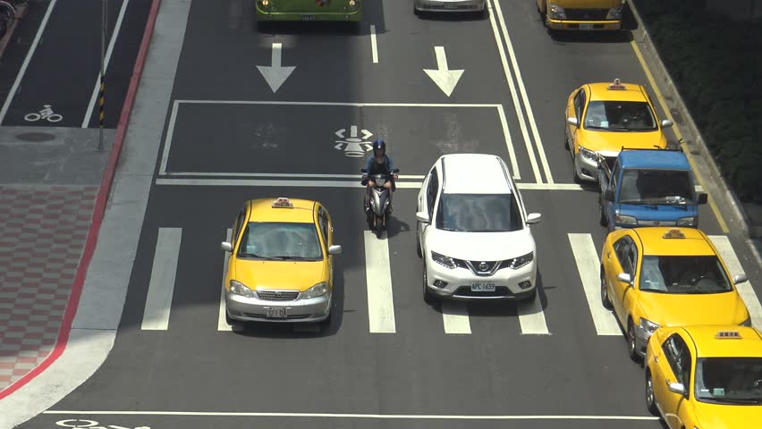 Taipei, Taiwan-21 June, 2016: 4K Aerial Traffic Cars, Motorbikes and Different Vehicles Driving On The Road in Busy Taipei City in the day-Dan | Shutterstock HD Video #19096795