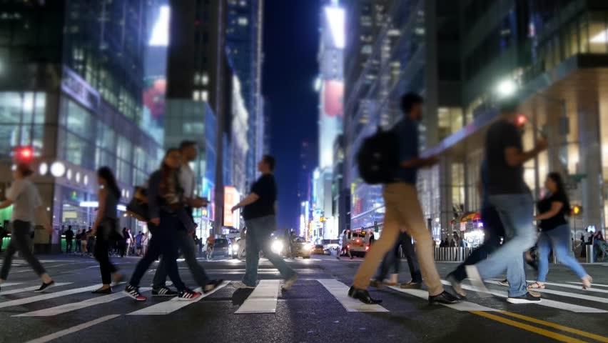 Pedestrians Crossing Crosswalk In City At Night. New York ...