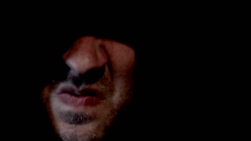 Scary hooded man appearing from darkness screaming #1917589