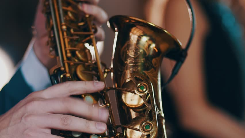 Saxophonist in dinner jacket play on golden saxophone. Live performance. Jazz music. | Shutterstock HD Video #19181632