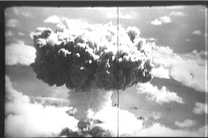 Footage shot from an airplane gives an aerial view of the mushroom cloud accompanying an atomic bomb test off the Bikini Islands in 1946. (1940s)