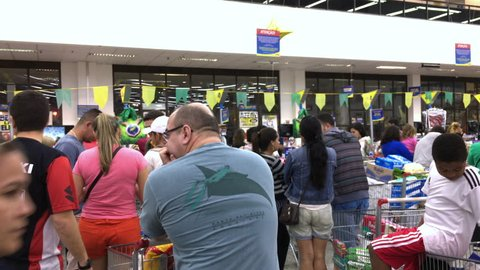 RIO DE JANEIRO, BRAZIL - AUGUST 13: Long lines at busy super market in Rio de Janeiro, Brazil on August 13, 2016 during Olympic Games season.