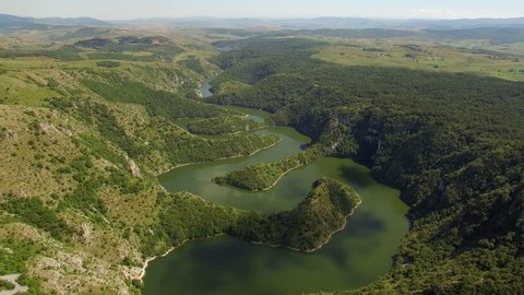 Aerial: flight over the trail and lake Uvac in Serbia.