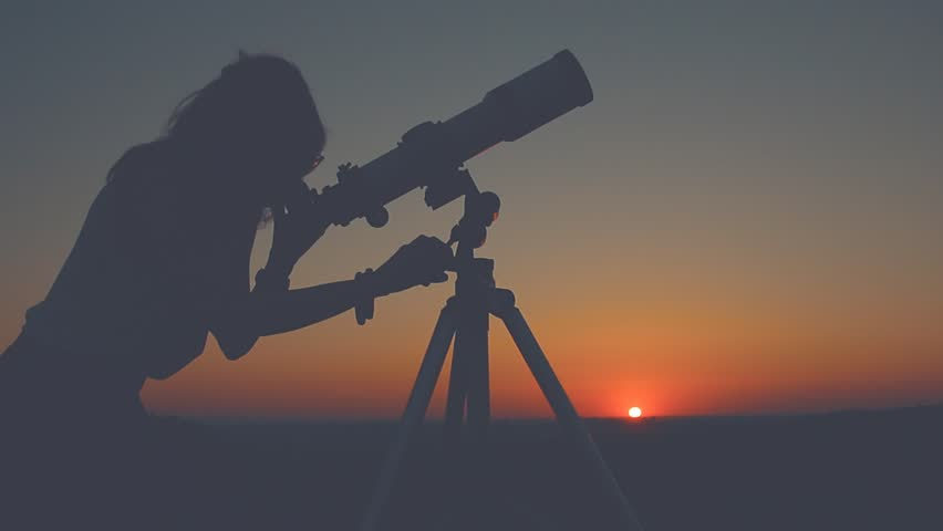 Woman-looking-at-city-through-telescope Image
