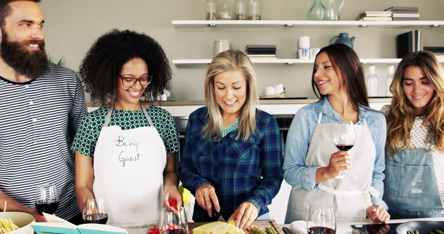 Friends having fun and laughing while cooking in kitchen, concept of good life food and drinks #19230445