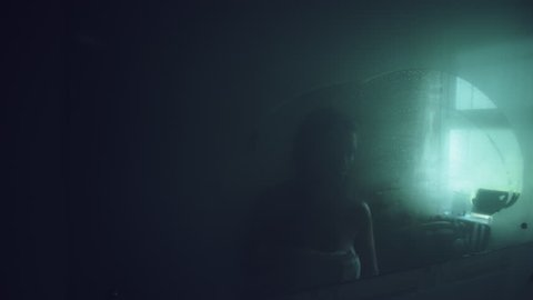 4k Thriller Shot of a Woman in Bath Room Wiping the Mirror