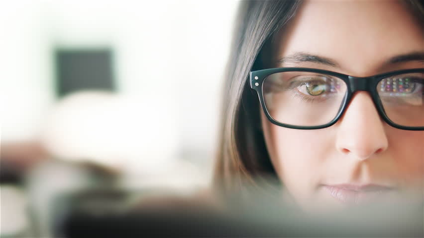 Attractive young woman working in a touchscreen computer or tablet. Businesswoman with glasses in an office space. Technology. Daylight. Dolly shot.  | Shutterstock HD Video #19244092
