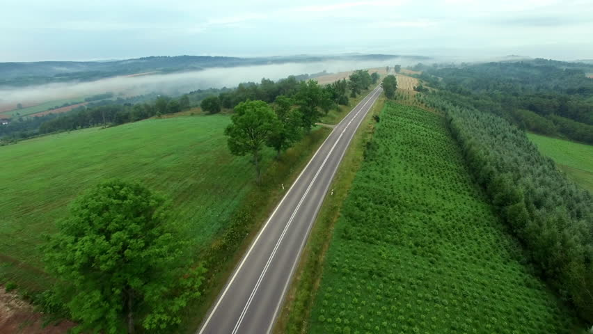 Aerial View Of Car On Foggy Rural Road | Shutterstock HD Video #19270852