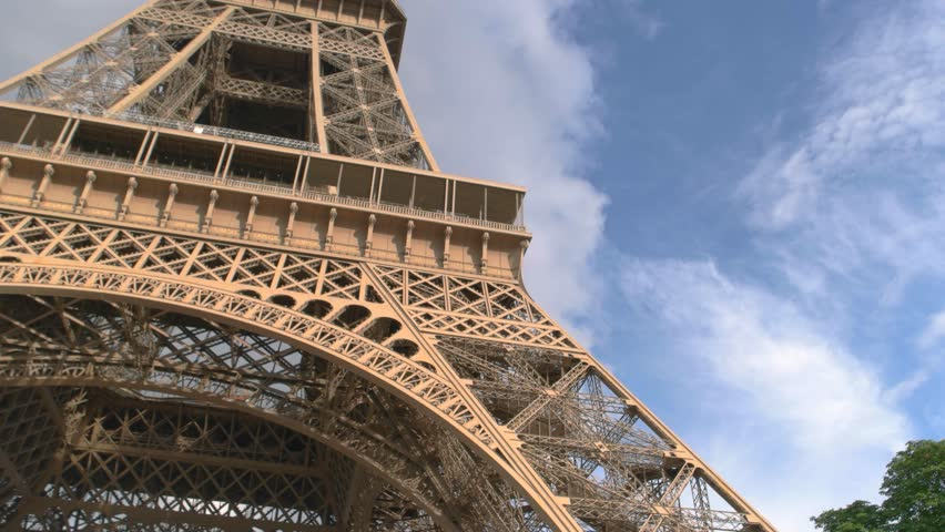 Eiffel tower and cloudy sky. View of monument from below. Most famous sight of Paris. Where to make a proposal. | Shutterstock HD Video #19298425