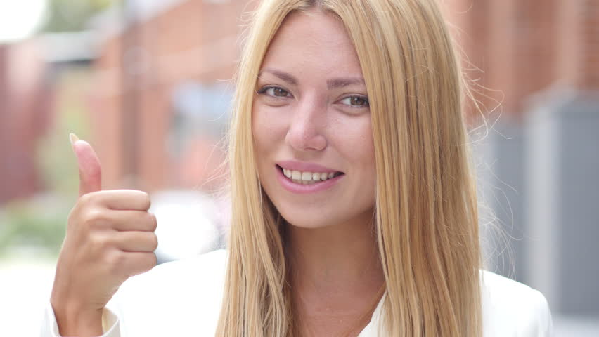 Thumb Up by Young Beautiful Girl, Outdoor Portrait | Shutterstock HD Video #19306675