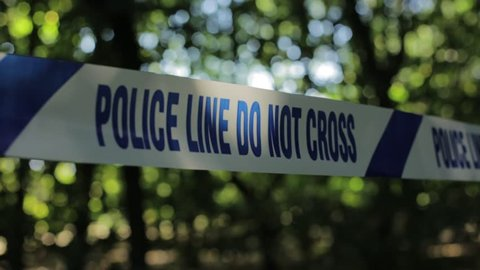 Close up of English Police Tape in Forest
