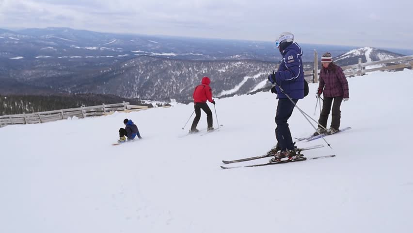 Russia, Sheregesh, 26 march 2015, People skiing and snowboarding on a slope at ski resort in slowmotion. 1920x1080 | Shutterstock HD Video #19344862