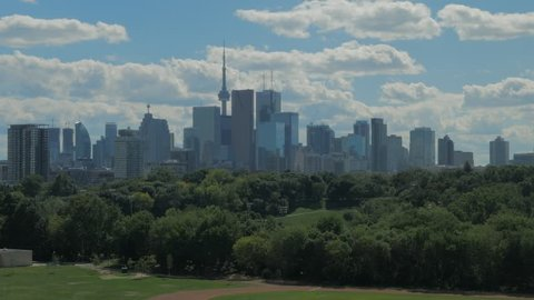 Toronto, Canada - CIRCA: August, 2016: Toronto buildings and skyline with clouds and blue sky overlooking Riverdale Field Park