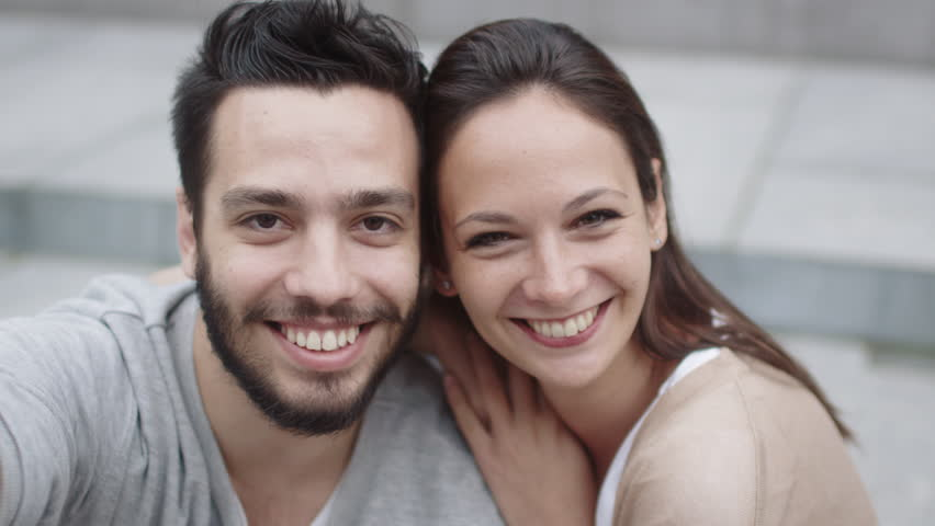 Happy smiling Couple looking at Camera and Doing Selfie. Shot on RED Cinema Camera in 4K (UHD). | Shutterstock HD Video #19366762